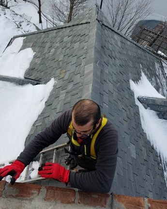Working on Roof in the Snow